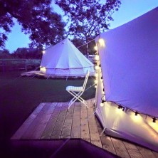 Belltents lit up with festoon lights
